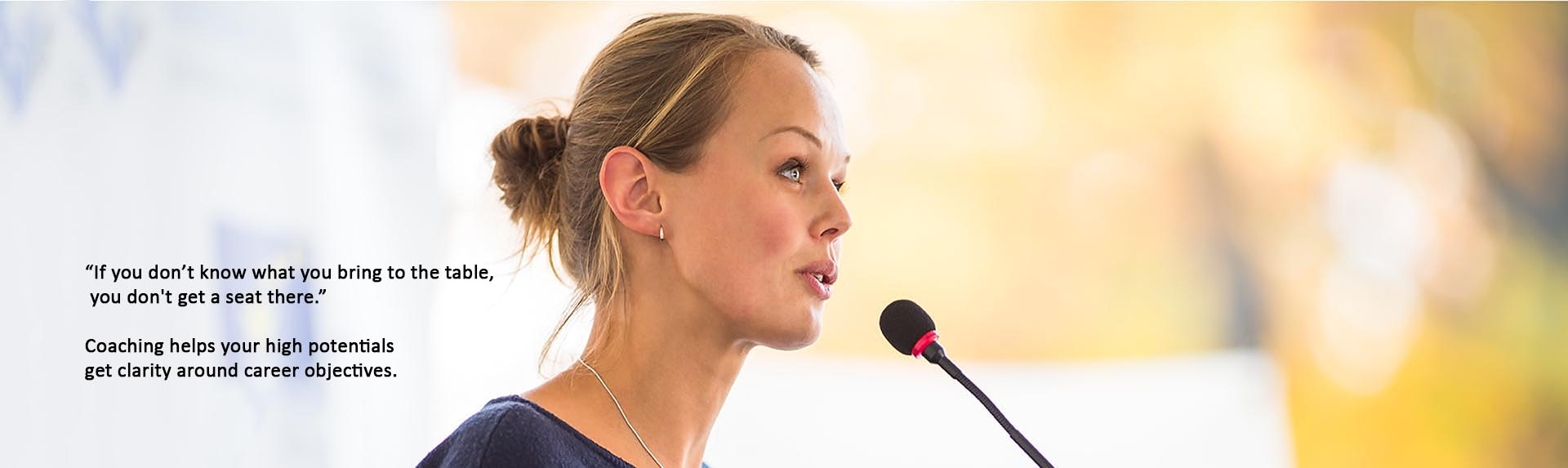 attractive business woman speaking into microphone