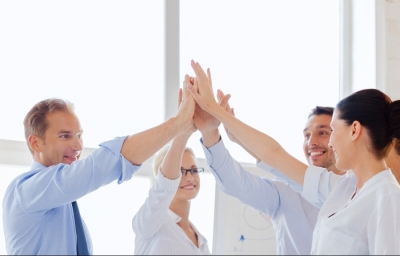 Business team high-fiving together