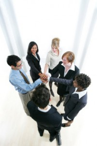 Business team right hands placed on top of each other in a circle - Ready to cheer